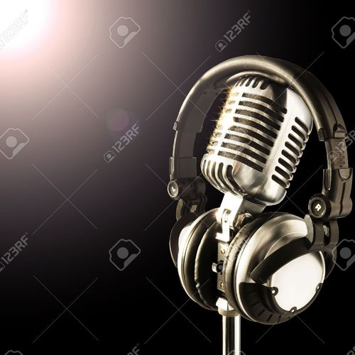 Default 633335 shiny professional mic and headphones in spotlight stock photo